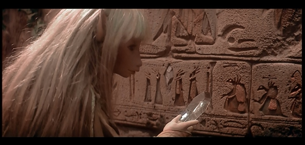 Kira at the Gelfling Wall of Destiny (screenshot from The Dark Crystal)